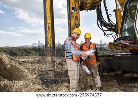 Engineer Shows Construction Worker  - stock photo