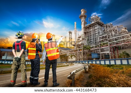 Engineer team in uniform are safety survey of the oil refiner industry - stock photo