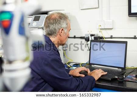 Engineer Using Computerized CMM Arm In Factory - stock photo