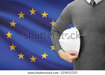 Engineer with flag on background  - European Union - stock photo