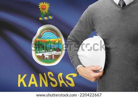 Engineer with flag on background series - Kansas - stock photo