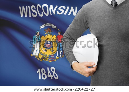 Engineer with flag on background series - Wisconsin - stock photo