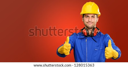 Engineer With Thumb Up Sign Isolated On Red Background - stock photo
