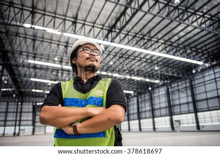 Engineer working and standing in new warehouse and space area - stock photo