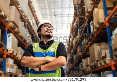 Engineer working and standing in warehouse  - stock photo