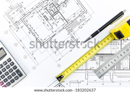 Engineering and architecture drawings and work tools - ruler, pencil, calculator, tape measure - stock photo