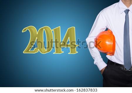 Engineering. business man marking new year  2014  - stock photo