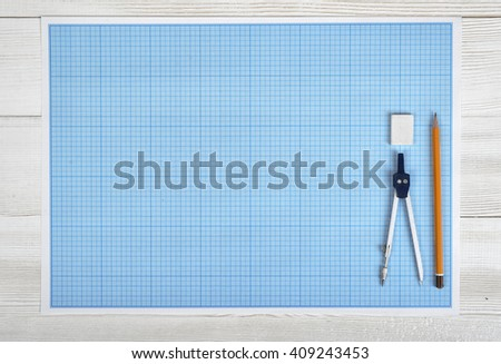 Engineering divider, pencil and eraser on a blueprint in top view - stock photo