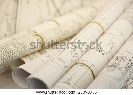 Engineering Drawings blueprints rolled for review and approval - stock photo