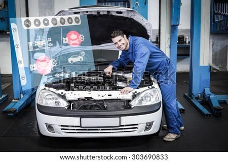 Engineering interface against mechanic examining under hood of car - stock photo