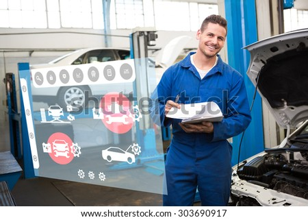Engineering interface against smiling mechanic looking at camera - stock photo