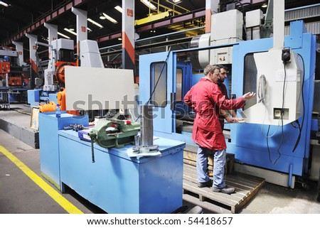 engineering people manofacturing industry with big modern computer mashines - stock photo