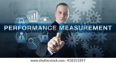 Engineering professional is pressing PERFORMANCE MEASUREMENT on a virtual interactive flat screen. Business concept for collecting data and analyzing information on processes and corporate strategy. - stock photo