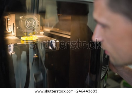 Engineering student using 3d printer at the university - stock photo