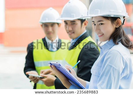 Engineering teams are working The cargo container - stock photo