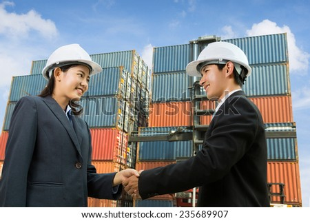 Engineers handshake agreed to buy container - stock photo