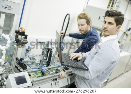 Engineers in the factory - stock photo