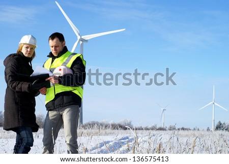 engineers with wind turbines - stock photo