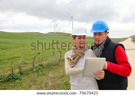 Engineers working with electronic tablet - stock photo