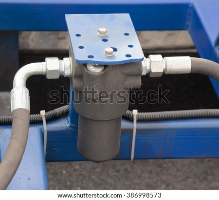 engines fuel filter and hoses of large construction machine - stock photo