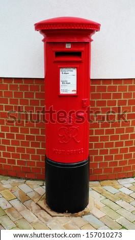 England Big red pillar box post box  - stock photo