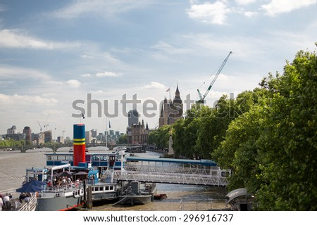 England, London - Big Ben, the Houses of Parliament and Westminster bridge over Thames river - stock photo