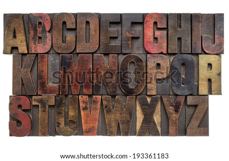 English alphabet in letterpress wood type printing blocks, stained by color inks - stock photo