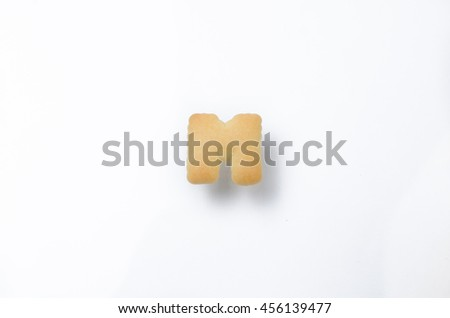 English alphabet made from bread. Letters of the British alphabet made of gingerbread. The letter M - stock photo