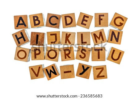 English alphabet on wooden blocks in four rows isolated over white - stock photo