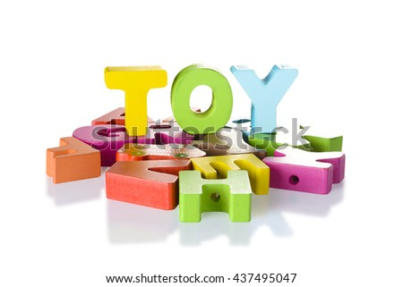 English alphabet wood arranged in the word TOY on isolated white background.with clipping path. - stock photo