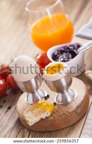 English breakfast on dark wooden table. Studio shoot - stock photo