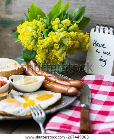 English breakfast with sausage and eggs. - stock photo