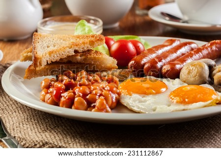 English breakfast with sausage, eggs and beans - stock photo