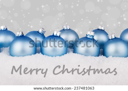 english Christmas card with blue christmas balls and text merry christmas/merry christmas/english  - stock photo
