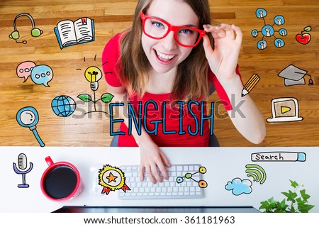 English concept with young woman wearing red glasses in her home office - stock photo