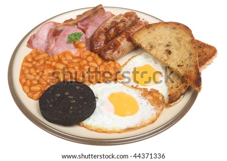 English cooked breakfast with fried bread, baked beans and black pudding. - stock photo