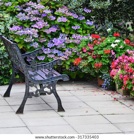 English country garden rustic patio area at the end of summer going into autumn - stock photo