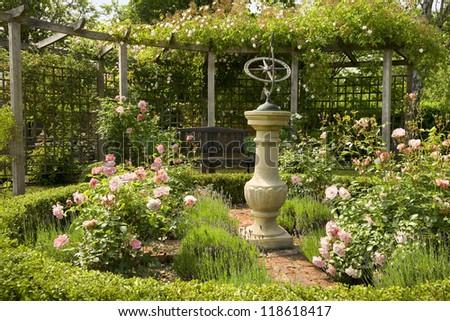English country rose garden with sundial - stock photo