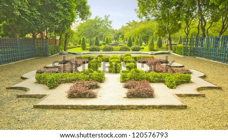 English garden in summer, Lush Green Topiary - stock photo