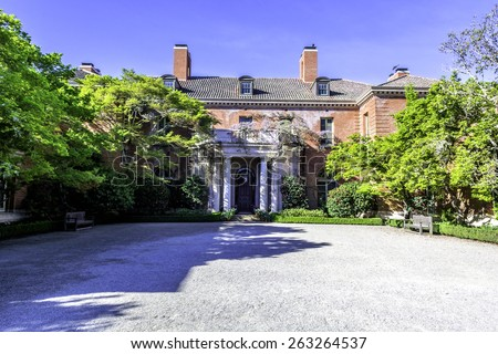 english garden mansion with courtyard - stock photo