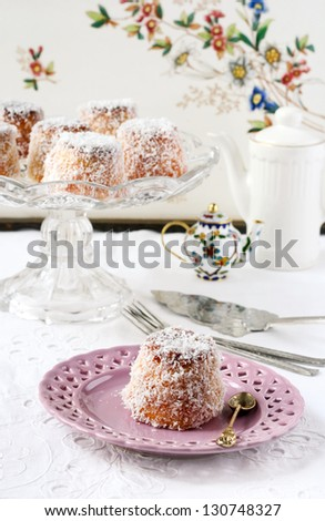 English madeleines on the cake dish and plate - stock photo