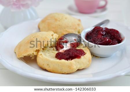English scones with cream and strawberry jam - stock photo