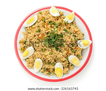 English-style breakfast kedgeree, a meal of rice, smoked fish, eggs and vegetables. - stock photo