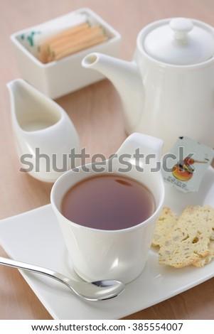 English tea with brown sugar, milk and tea set  - stock photo