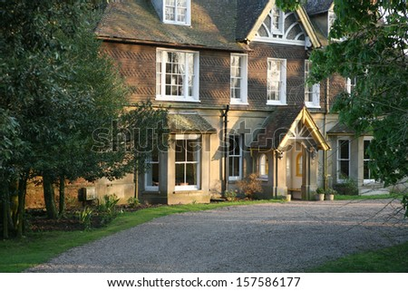 English victorian style vicarage in moody evening light - stock photo