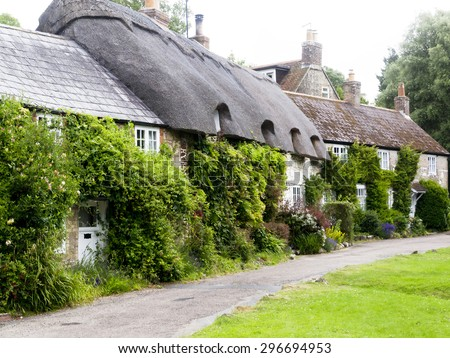 English Village Street; Picturesque traditional English village street  - stock photo