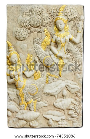 Engraving Thai angel on stone wall - isolated - stock photo