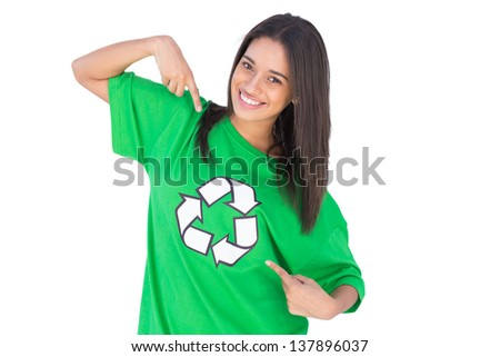 Enivromental activist pointing to the recycling symbol on her green tshirt - stock photo