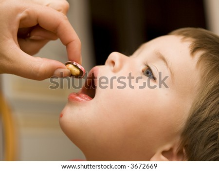 Enjoy a candy, baby! - stock photo