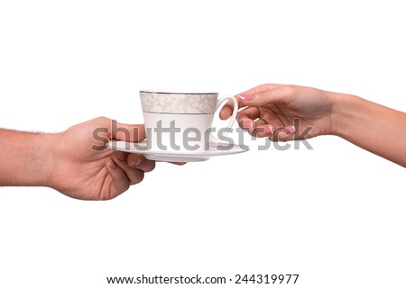 Enjoy the cup of coffee! Cropped image of the cup of coffee passing from one hand to another isolated on white background - stock photo